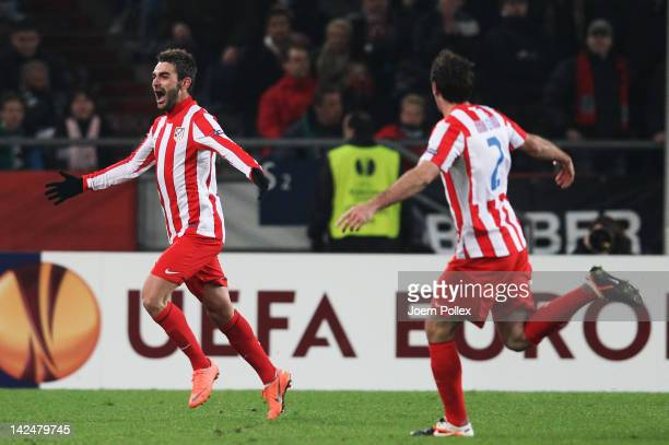 Adrian Lopez of Madrid celebrates after scoring his team's first goal during the UEFA Europa League Quarter Final second leg match between Hannover...