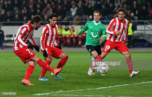 Adrian Lopez of Madrid scores his team's opening goal during the UEFA Europa League quarterfinal second leg match between Hannover 96 and Atletico de...