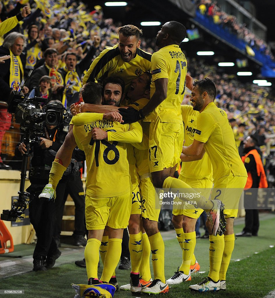 Adrian Lopez of Villarreal CF celebrates with teammates after scoring his team's opening goal during the Europa League Semi Final first leg match between Villarreal CF and Liverpool at El Madrigal stadium on April 28, 2016 in Villarreal, Spain.