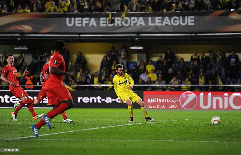 Adrian Lopez of Villarreal CF cores his team's opening goal during the Europa League Semi Final first leg match between Villarreal CF and Liverpool at El Madrigal stadium on April 28, 2016 in Villarreal, Spain.