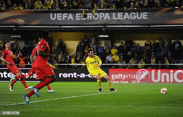 Adrian Lopez of Villarreal CF cores his team's opening goal during the Europa League Semi Final first leg match between Villarreal CF and Liverpool...