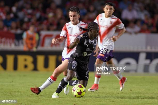 Adrian Luna and Jesus Paganoni of Veracruz Yimmi Chara of Monterrey fight for the ball during the 16th round match between Veracruz and Monterrey as...