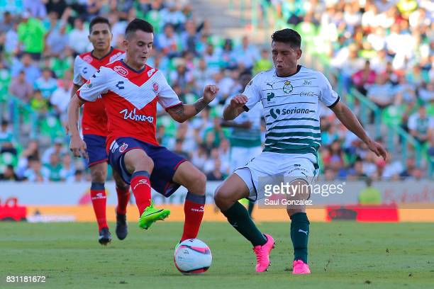 Adrian Luna of Veracruz and Gael Sandoval of Santos fight for the ball during the 4th round match between Santos Laguna and Veracruz as part of the...