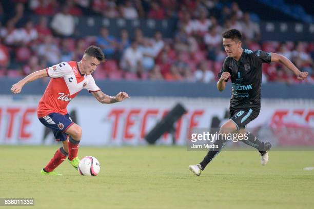 Adrian Luna of Veracruz and Javier Guemez of Queretaro fight for the ball during the fifth round match between Veracruz and Queretaro as part of the...
