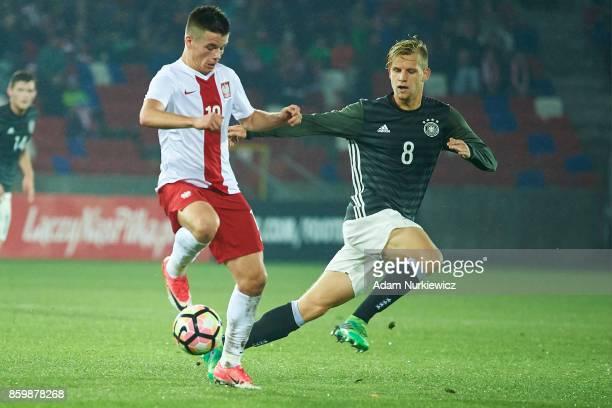 Adrian Lyszczarz of U19 Poland fights for the ball with Arne Maier of U19 Germany during soccer match U19 Poland v U19 Germany UEFA Under19 Euro...