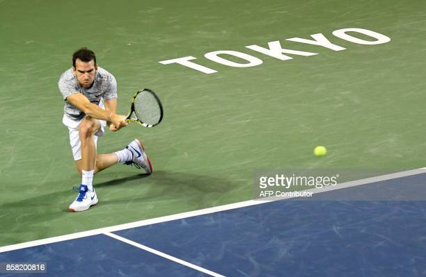 Adrian Mannarino of France hits a return against Yuichi Sugita of Japan during their men's singles quarterfinal match at the Japan Open tennis...