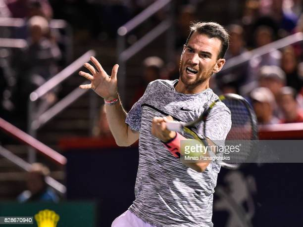 Adrian Mannarino of France hits a return shot against Milos Raonic of Canada during day six of the Rogers Cup presented by National Bank at Uniprix...