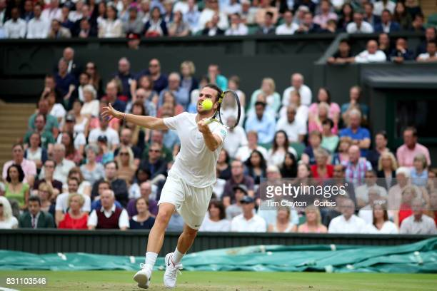 Adrian Mannarino of France in action against Novak Djokovic of Serbia in the Gentlemen's Singles round of sixteen at the Wimbledon Lawn Tennis...