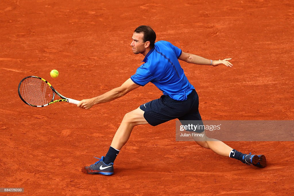 <a gi-track='captionPersonalityLinkClicked' href=/galleries/search?phrase=Adrian+Mannarino&family=editorial&specificpeople=5361274 ng-click='$event.stopPropagation()'>Adrian Mannarino</a> of France plays a backhand during the Men's Singles second round match against Milos Raonic of Canada on day four of the 2016 French Open at Roland Garros on May 25, 2016 in Paris, France.