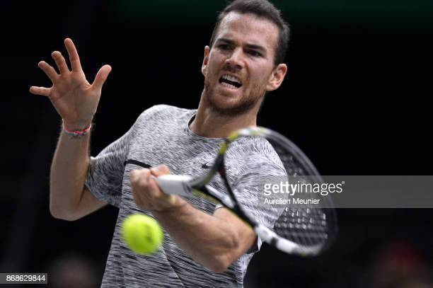 Adrian Mannarino of France plays a forehand in the men's single first round match against David Ferrer of Spain during day two of the Rolex Paris...