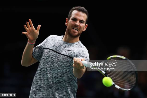Adrian Mannarino of France returns a forehand against David Ferrer of Spain during Day 2 of the Rolex Paris Masters held at the AccorHotels Arena on...