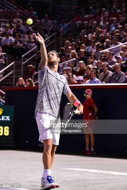 Adrian Mannarino of France serves against Milos Raonic of Canada during day six of the Rogers Cup presented by National Bank at Uniprix Stadium on...