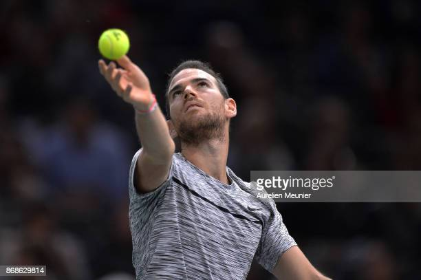Adrian Mannarino of France serves in the men's single first round match against David Ferrer of Spain during day two of the Rolex Paris Masters at...