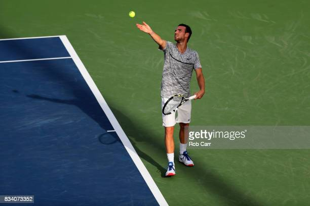 Adrian Mannarino of France serves to Dominic Thiem of Austria during Day 6 of the Western and Southern Open at the Linder Family Tennis Center on...