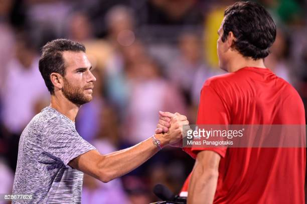 Adrian Mannarino of France shakes hands with Milos Raonic of Canada during day six of the Rogers Cup presented by National Bank at Uniprix Stadium on...