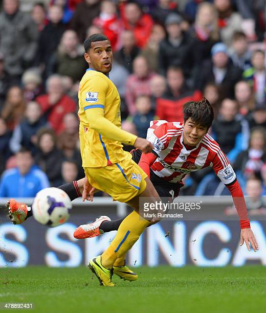 Adrian Mariappa of Crystal Palace tries to block Ki SungYong of Sunderland's effort at goal during the Barclays Premier League match between...