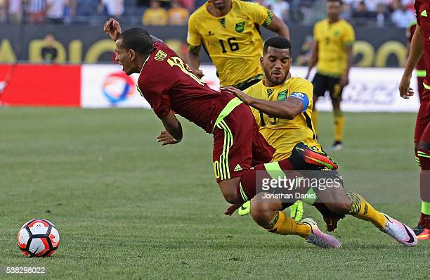 Adrian Mariappa of Jamaica takes down Romulo Otero of Venezuela during a match in the 2016 Copa America Centenario at Soldier Field on June 5 2016 in...