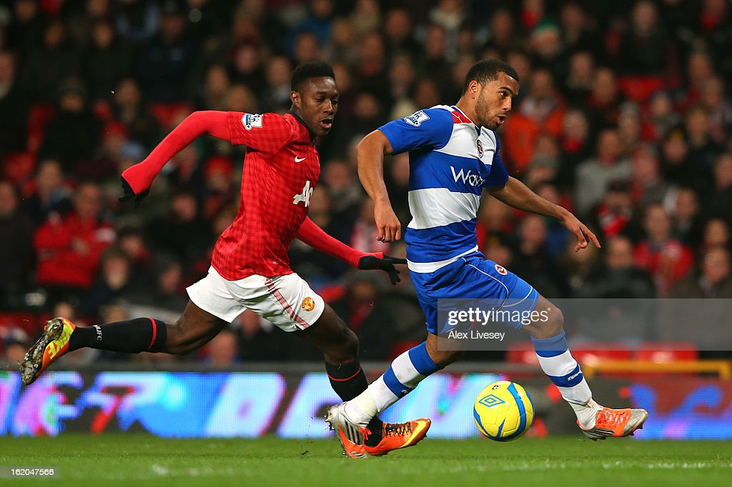 Adrian Mariappa of Reading shields the ball from Danny Welbeck of Manchester United during the FA Cup Fifth Round match between Manchester United and Reading at Old Trafford on February 18, 2013 in Manchester, England.
