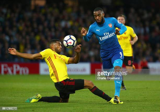 Adrian Mariappa of Watford and Alexandre Lacazette of Arsenal compete for the ball during the Premier League match between Watford and Arsenal at...