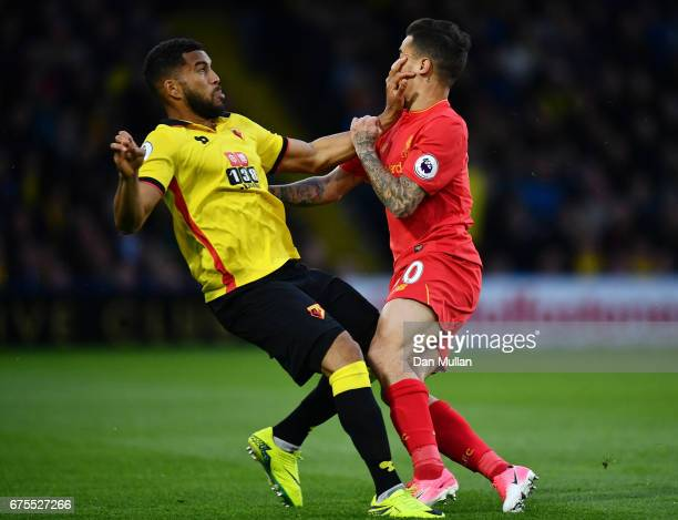 Adrian Mariappa of Watford and Philippe Coutinho of Liverpool collide during the Premier League match between Watford and Liverpool at Vicarage Road...