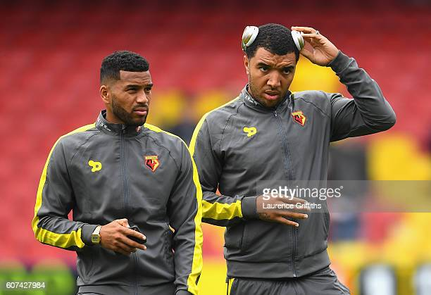 Adrian Mariappa of Watford and Troy Deeney of Watford speak while taking a look around the pitch before kick off during the Premier League match...