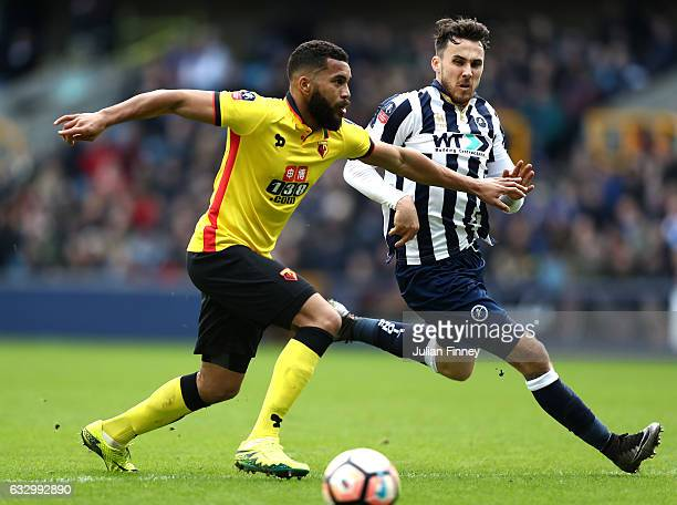 Adrian Mariappa of Watford attempts to take the ball past Lee Gregory of Millwall during The Emirates FA Cup Fourth Round match between Millwall and...