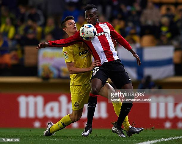 Adrian Marin of Villarreal competes for the ball with Inaki Williams of Athletic Club during the Copa del Rey Round of 16 second leg match between...