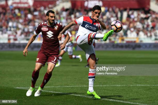 Adrian Marius Stoian of FC Crotone in action against Davide Zappacostaof FC Torino during the Serie A match between FC Torino and FC Crotone at...