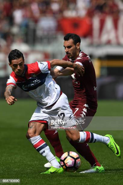 Adrian Marius Stoian of FC Crotone is challenged by Davide Zappacostaof FC Torino during the Serie A match between FC Torino and FC Crotone at Stadio...