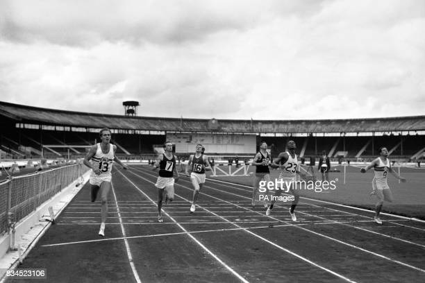 Adrian Metcalfe no 13 winning the 440 yards final from R Freeman no 23 of the USA third BD Jackson no 9 and fourth Tim Graham no7 Adrian Metcalfe and...
