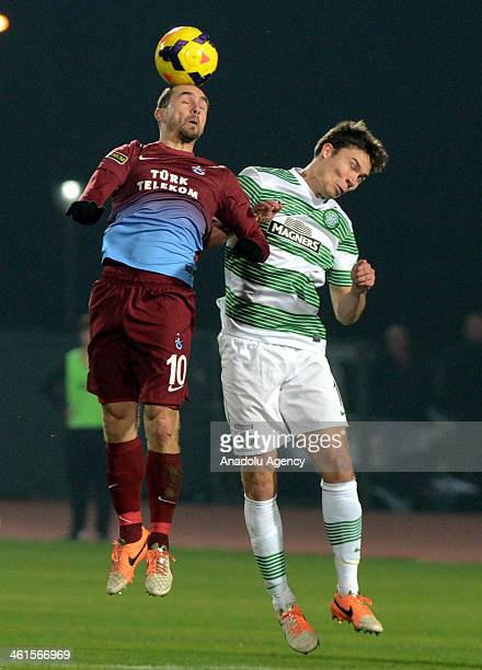 Adrian Mierzejewski struggles with Derk Boerrigter during the soccer match between Trabzonspor and Celtic in Turkish Airlines Cup 2014 on January 9...