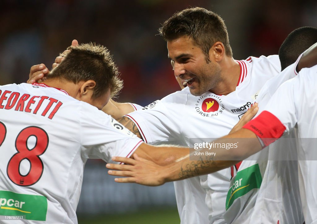 <a gi-track='captionPersonalityLinkClicked' href=/galleries/search?phrase=Adrian+Mutu&family=editorial&specificpeople=211247 ng-click='$event.stopPropagation()'>Adrian Mutu</a> of AC Ajaccio congratulates <a gi-track='captionPersonalityLinkClicked' href=/galleries/search?phrase=Benoit+Pedretti&family=editorial&specificpeople=714997 ng-click='$event.stopPropagation()'>Benoit Pedretti</a> (L) for his opening goal during the Ligue 1 match between Paris Saint Germain FC and AC Ajaccio at the Parc des Princes stadium on August 18, 2013 in Paris, France.