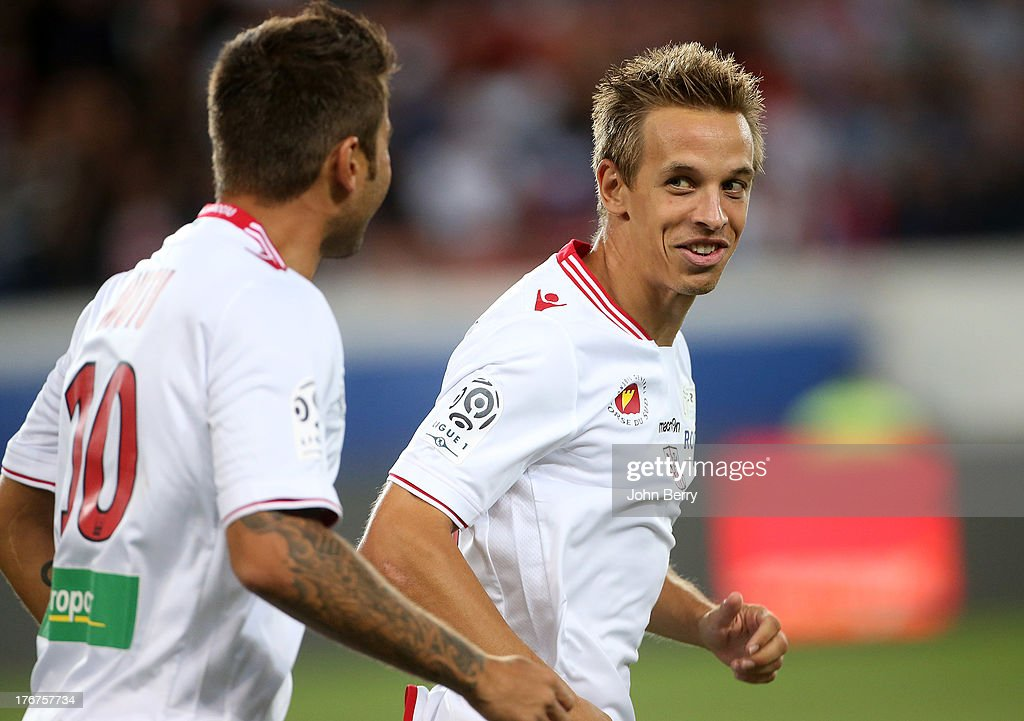 <a gi-track='captionPersonalityLinkClicked' href=/galleries/search?phrase=Adrian+Mutu&family=editorial&specificpeople=211247 ng-click='$event.stopPropagation()'>Adrian Mutu</a> of AC Ajaccio congratulates teammate <a gi-track='captionPersonalityLinkClicked' href=/galleries/search?phrase=Benoit+Pedretti&family=editorial&specificpeople=714997 ng-click='$event.stopPropagation()'>Benoit Pedretti</a> for his opening goal during the Ligue 1 match between Paris Saint Germain FC and AC Ajaccio at the Parc des Princes stadium on August 18, 2013 in Paris, France.