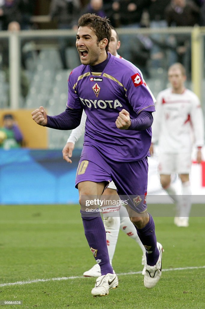 <a gi-track='captionPersonalityLinkClicked' href=/galleries/search?phrase=Adrian+Mutu&family=editorial&specificpeople=211247 ng-click='$event.stopPropagation()'>Adrian Mutu</a> of ACF Fiorentina celebrates after scoring a goal during the Serie A match between Fiorentina and Bari at Stadio Artemio Franchi on January 10, 2010 in Florence, Italy.