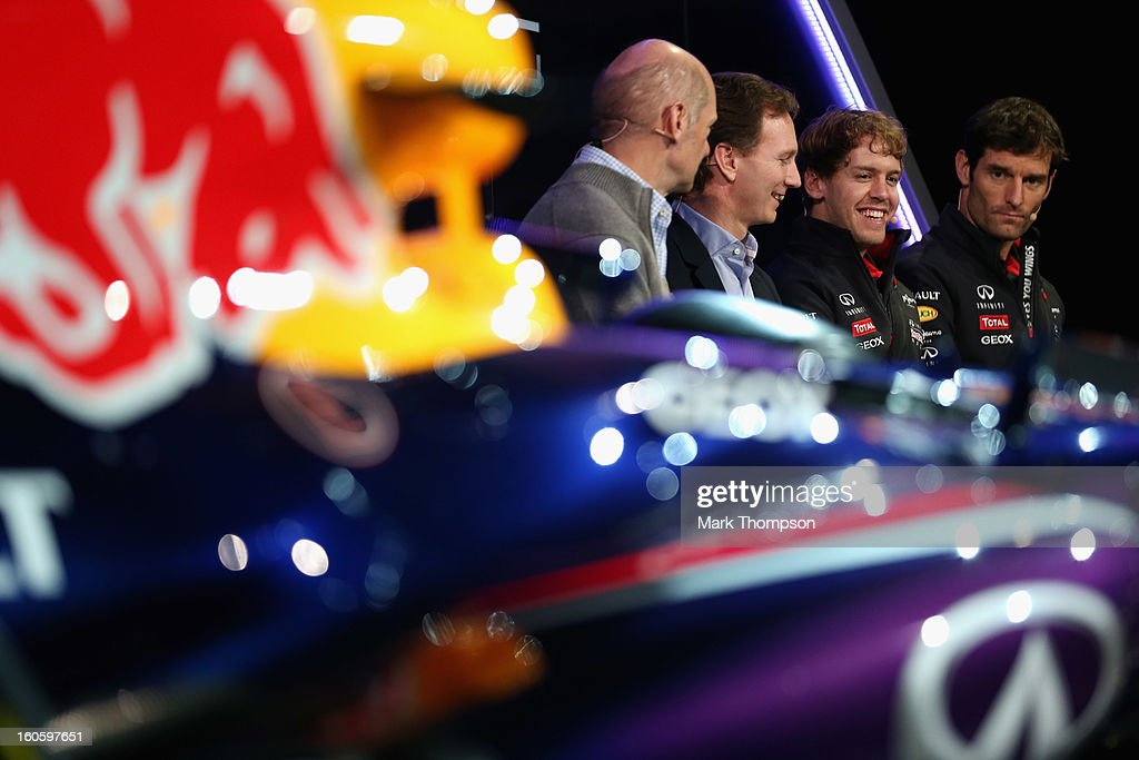 <a gi-track='captionPersonalityLinkClicked' href=/galleries/search?phrase=Adrian+Newey&family=editorial&specificpeople=215410 ng-click='$event.stopPropagation()'>Adrian Newey</a>, Chief Technical Officer, <a gi-track='captionPersonalityLinkClicked' href=/galleries/search?phrase=Christian+Horner&family=editorial&specificpeople=228706 ng-click='$event.stopPropagation()'>Christian Horner</a>, Team Principle, <a gi-track='captionPersonalityLinkClicked' href=/galleries/search?phrase=Mark+Webber+-+Race+Car+Driver&family=editorial&specificpeople=167271 ng-click='$event.stopPropagation()'>Mark Webber</a> of Australia, and <a gi-track='captionPersonalityLinkClicked' href=/galleries/search?phrase=Sebastian+Vettel&family=editorial&specificpeople=2233605 ng-click='$event.stopPropagation()'>Sebastian Vettel</a> of Germany talk to the guests during the Infiniti Red Bull Racing RB9 launch on February 3, 2013 in Milton Keynes, England.