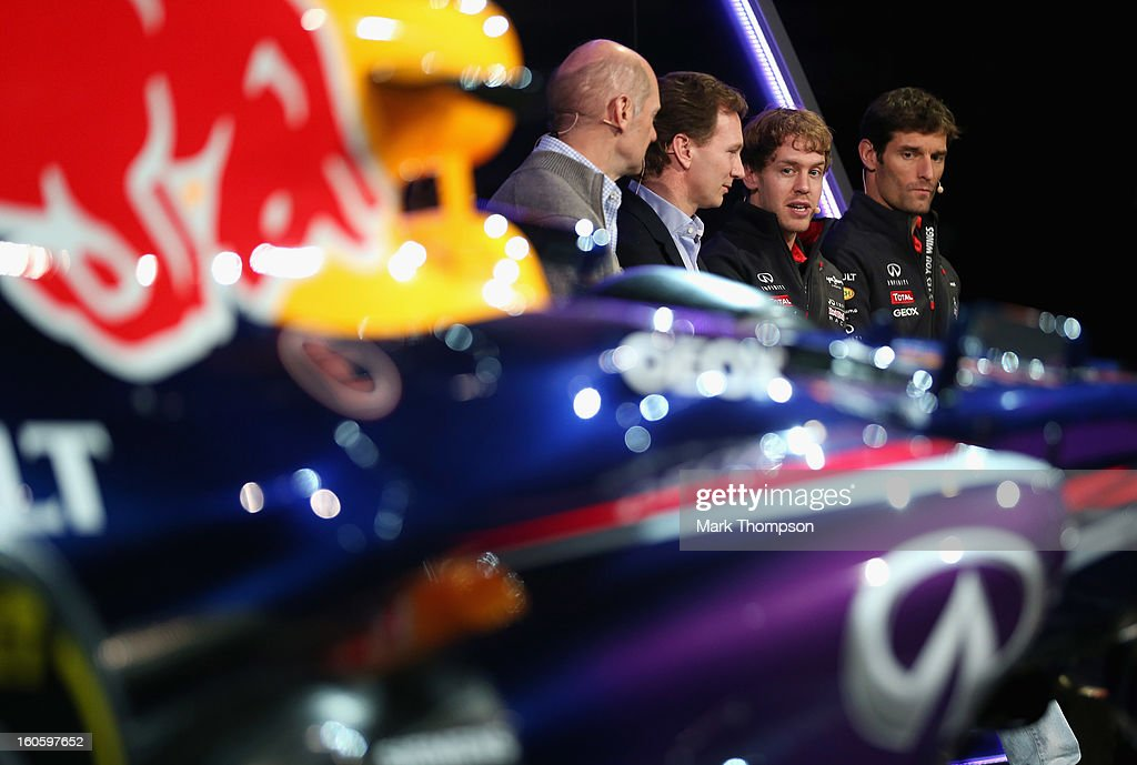 <a gi-track='captionPersonalityLinkClicked' href=/galleries/search?phrase=Adrian+Newey&family=editorial&specificpeople=215410 ng-click='$event.stopPropagation()'>Adrian Newey</a>, Chief Technical Officer, <a gi-track='captionPersonalityLinkClicked' href=/galleries/search?phrase=Christian+Horner&family=editorial&specificpeople=228706 ng-click='$event.stopPropagation()'>Christian Horner</a>, Team Principle, <a gi-track='captionPersonalityLinkClicked' href=/galleries/search?phrase=Mark+Webber+-+Piloto+de+coches+de+carreras&family=editorial&specificpeople=167271 ng-click='$event.stopPropagation()'>Mark Webber</a> of Australia, and <a gi-track='captionPersonalityLinkClicked' href=/galleries/search?phrase=Sebastian+Vettel&family=editorial&specificpeople=2233605 ng-click='$event.stopPropagation()'>Sebastian Vettel</a> of Germany talk to the guests during the Infiniti Red Bull Racing RB9 launch on February 3, 2013 in Milton Keynes, England.