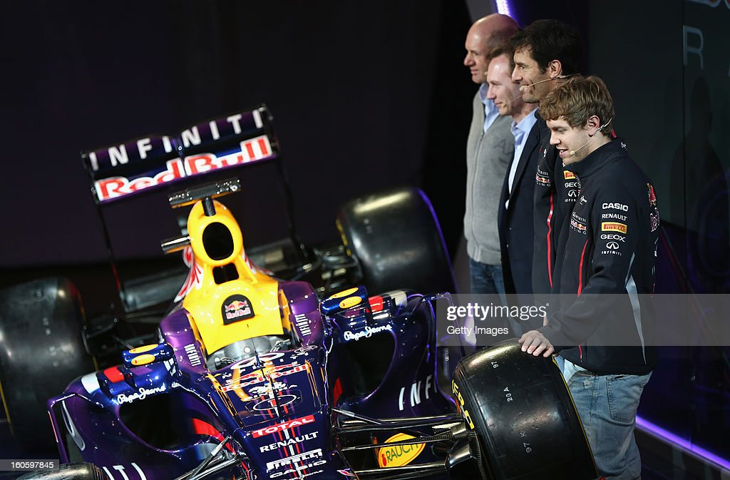 Adrian Newey, Chief Technical Officer, Christian Horner, Team Principle, Mark Webber of Australia, and Sebastian Vettel of Germany pose with the new car during the Infiniti Red Bull Racing RB9 launch on February 3, 2013 in Milton Keynes, England.