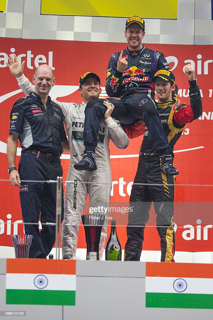 Adrian Newey of Red Bull and Great Britain Nico Rosberg of Germany and Mercedes race winner and 2013 Formula One World Champion Sebastian Vettel of...