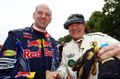 Adrian Newey Red Bull Racing Chief Technical Officer shakes hands with Brian Johnson of the band AC / DC during day one of The Goodwood Festival of...