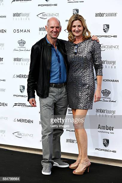 Adrian Newey the Chief Technical Officer of Red Bull Racing arrives at the Amber Lounge fashion show with Louise Goodman TV presenter during previews...