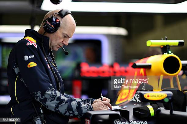 Adrian Newey the Chief Technical Officer of Red Bull Racing looks at the car in the garage during practice for the Formula One Grand Prix of Great...