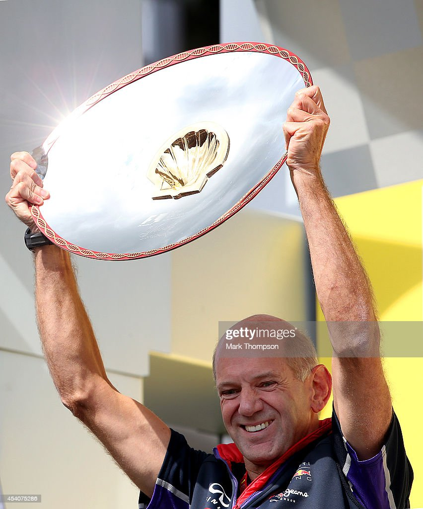 <a gi-track='captionPersonalityLinkClicked' href=/galleries/search?phrase=Adrian+Newey&family=editorial&specificpeople=215410 ng-click='$event.stopPropagation()'>Adrian Newey</a>, the Infiniti Red Bull Racing Chief Technical Officer celebrates on the podium after the Belgian Grand Prix at Circuit de Spa-Francorchamps on August 24, 2014 in Spa, Belgium.