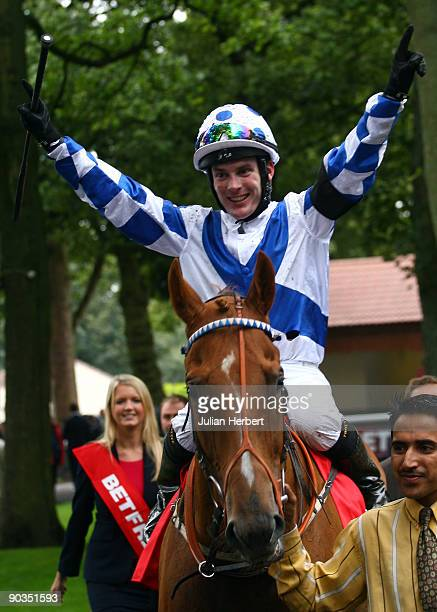 Adrian Nicholls and Regal Parade return after landing The Betfred Sprint Cup Race run at Haydock Racecourse on September 5 2009 in Haydock England