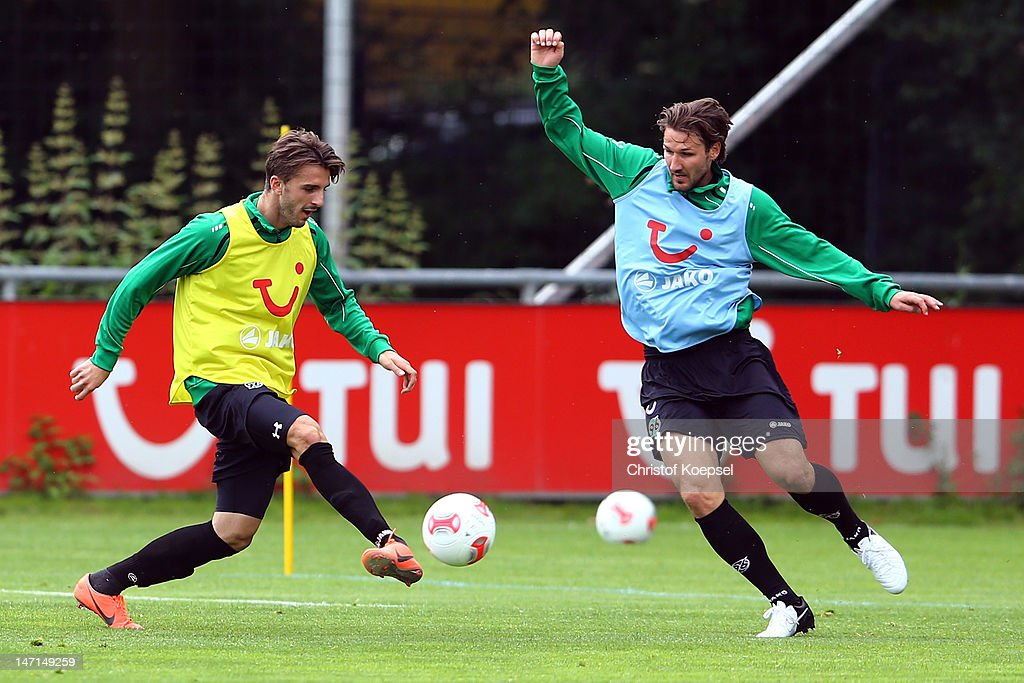 Adrian Nikci challenges Christian Schulz during the training session of Hannover 96 at Mehrkampfanlage on June 26 2012 in Hanover Germany