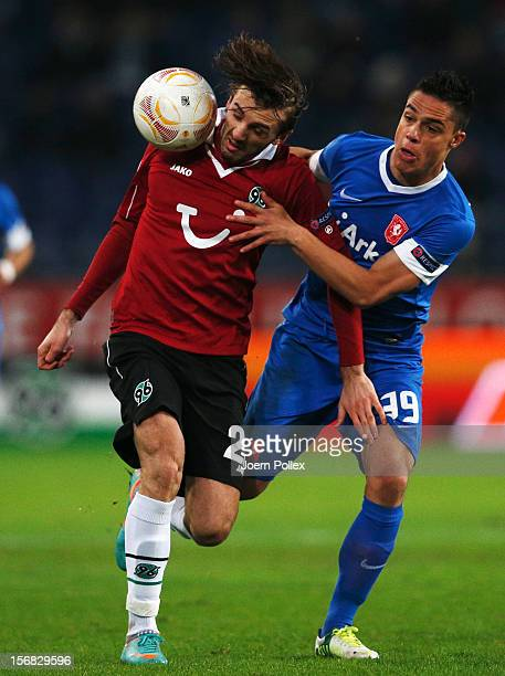 Adrian Nikci of Hannover and Joey Pelupessy of Hannover and x of Twente compete for the ball during the UEFA Europa League Group L match between...