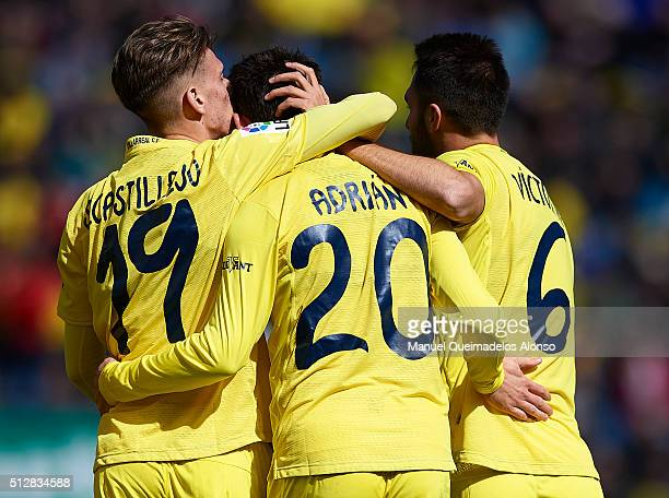 Adrian of Villarreal celebrates scoring his team's third goal with his temmates Samuel Castillejo and Victor Ruiz during the La Liga match between...
