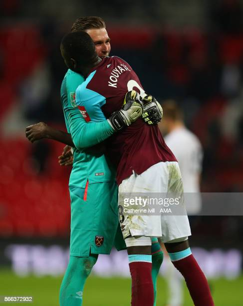 Adrian of West Ham United hugs Cheikhou Kouyate of West Ham United after the Carabao Cup Fourth Round match between Tottenham Hotspur and West Ham...