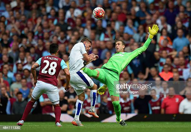 Adrian of West Ham United tackles Jamie Vardy of Leicester City resulting in the red card during the Barclays Premier League match between West Ham...