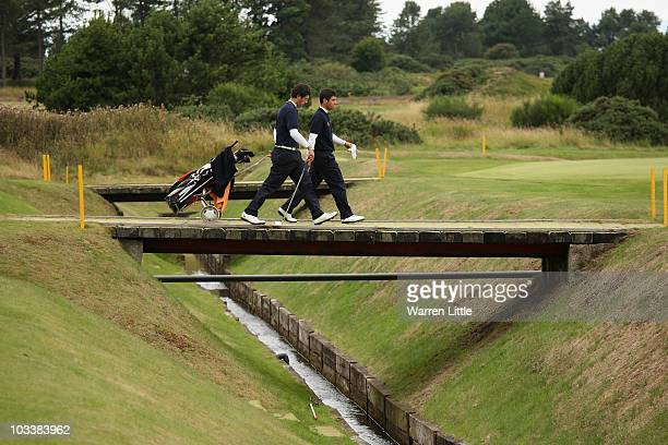 Adrian Otaegui of Spain crosses the bridge on the second fairway during his quarter final match against Julien Brun of France for the Boys Amateur...