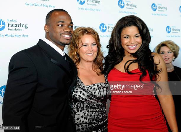 Adrian Petersen of the Minnesota Vikings with singer Jordin Sparks and her mother Jodi attends the 2010 Starkey Hearing Foundation 10th Annual 'So...